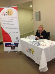 Dr. Maggie Goldraich at Gold Patents stand during the 2013 London Patent Summit